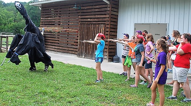 A creature from the shadow realm flees from the defending students. Best camp ever!